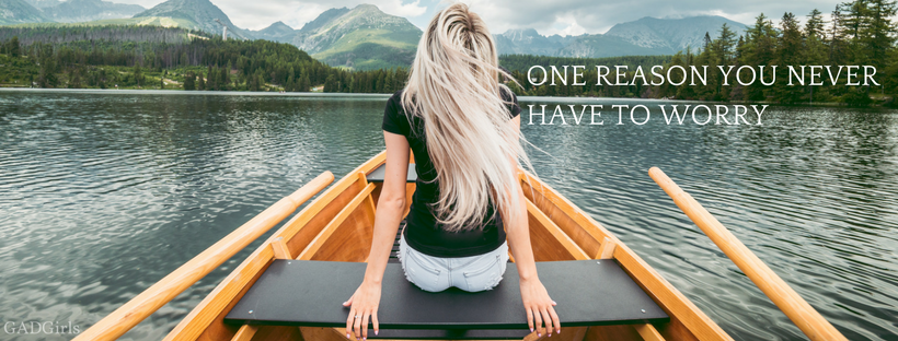 Girl on a boat looking into the mountains